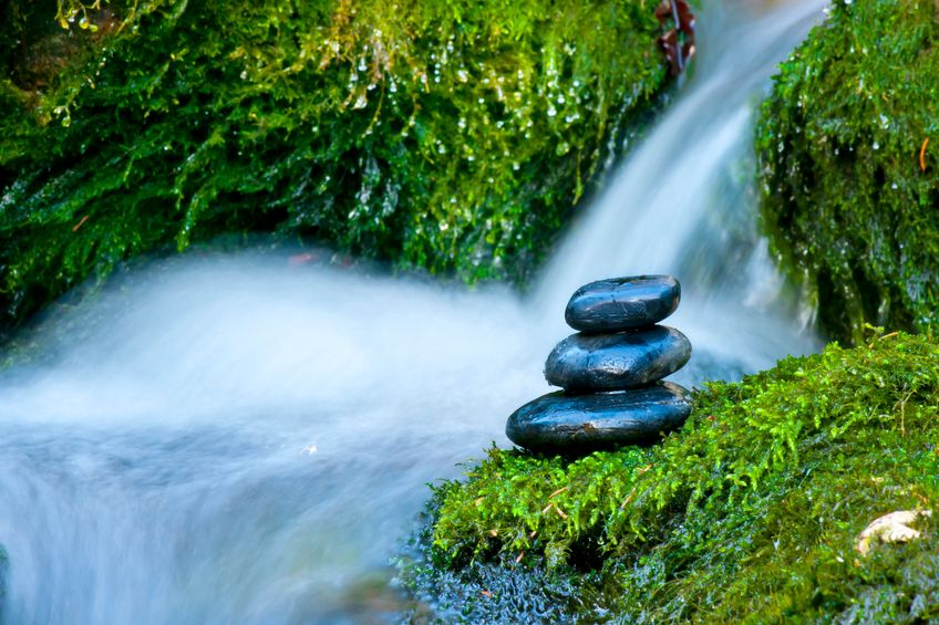 mountain spring with massage stones