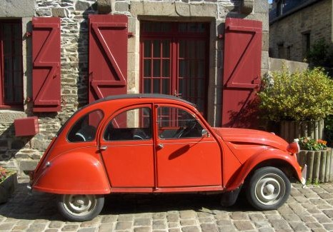 red 2cv car in france outside french property