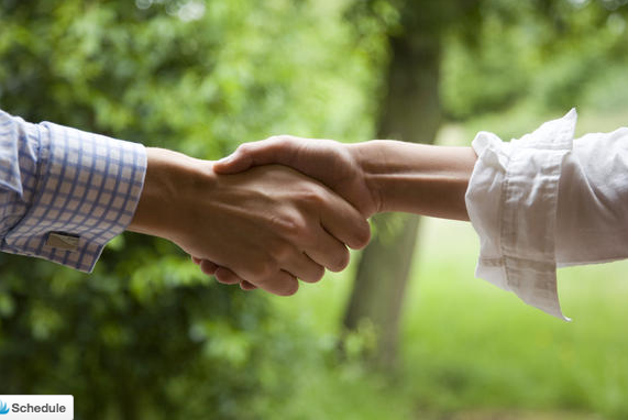 shaking hands after buying a property in france